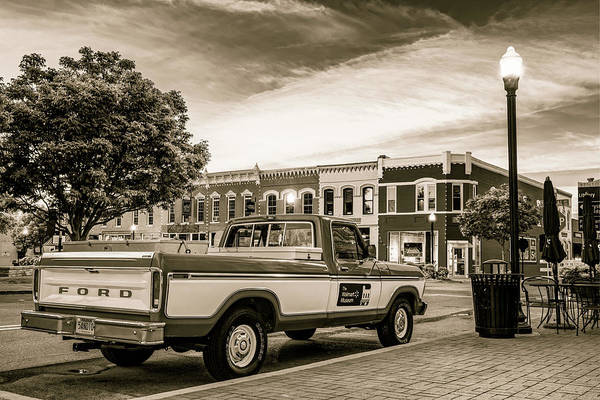 Photograph - Downtown Bentonville Arkansas Square Skyline And Sam Walton Walmart Museum Truck - Sepia by Gregory Ballos