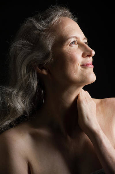 Gray Hair Photograph - Dramatic Portrait Of Mid-aged Woman by Leland Bobbe