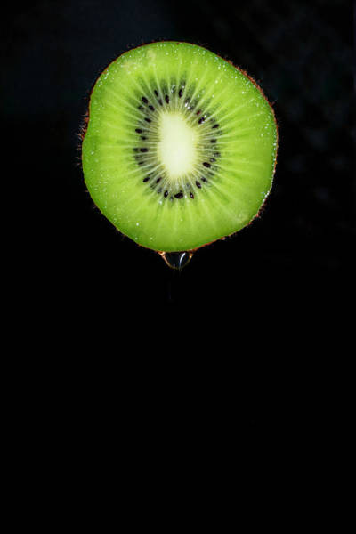 Kiwifruit Photograph - Dripping Kiwi by Sandi Kroll