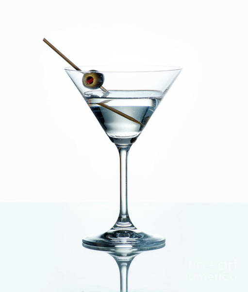 Photograph - Dry Martini With Green Olive In Cocktail Glass Over White Backgr by Jelena Jovanovic
