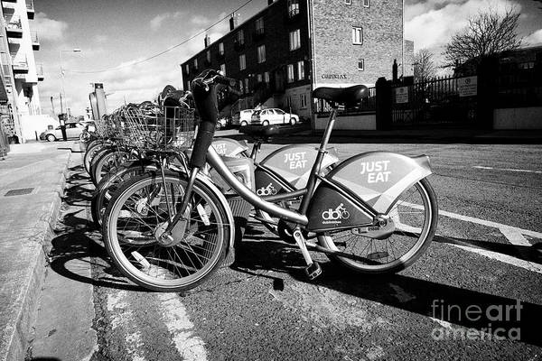Wall Art - Photograph - dublin bikes public bike hire rental scheme near camden lock in ringsend Dublin Republic of Ireland  by Joe Fox