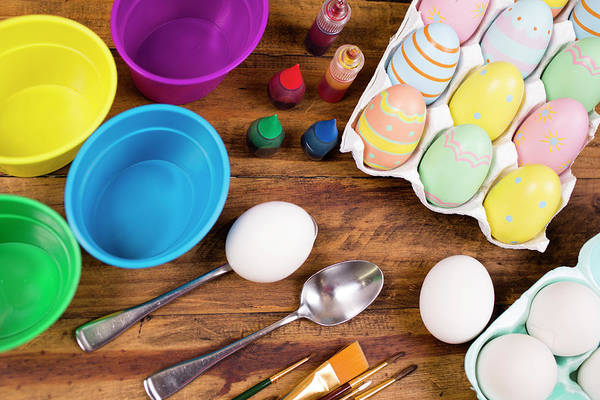 Wall Art - Photograph - Easter Eggs Being Decorated On Wooden by Fstop123