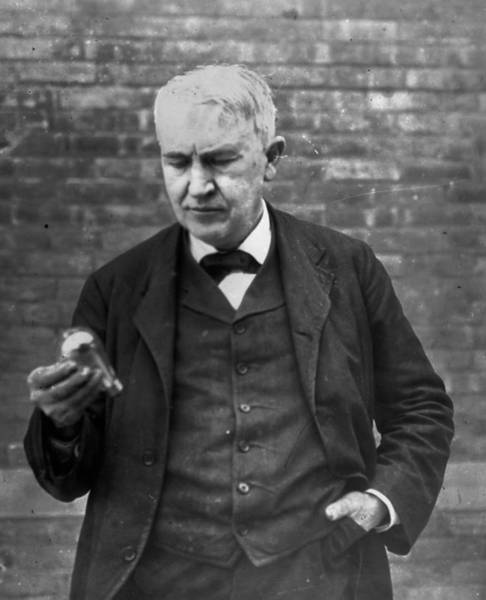 Physicist Photograph - Edison And Bulb by Hulton Archive
