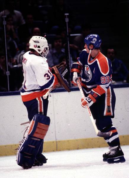 Ice Hockey Photograph - Edmonton Oilers V New York Islanders by B Bennett