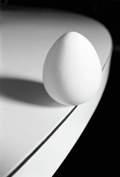 Photograph - Egg Carefully Balancing At The Edge Of by Scotspencer