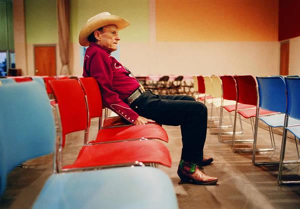 Auditorium Photograph - Elderly Man Wearing Cowboy Hat, Sitting by Reza Estakhrian