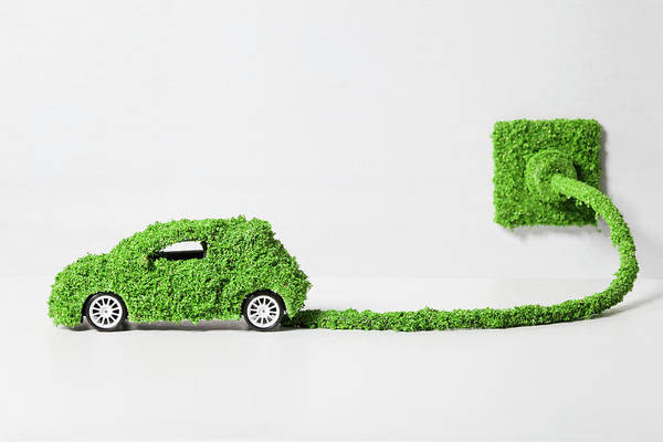 Environmental Issue Wall Art - Photograph - Electric Car Covered With Grass by Westend61