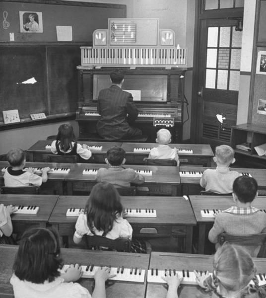 Chord Wall Art - Photograph - Elementary School Music Teacher Playing by Yale Joel