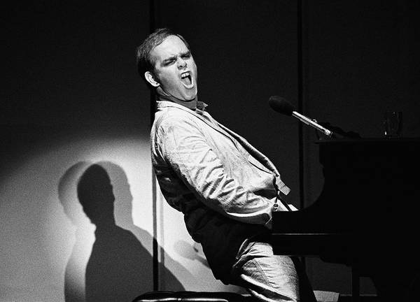 Photograph - Elton John In Concert by George Rose