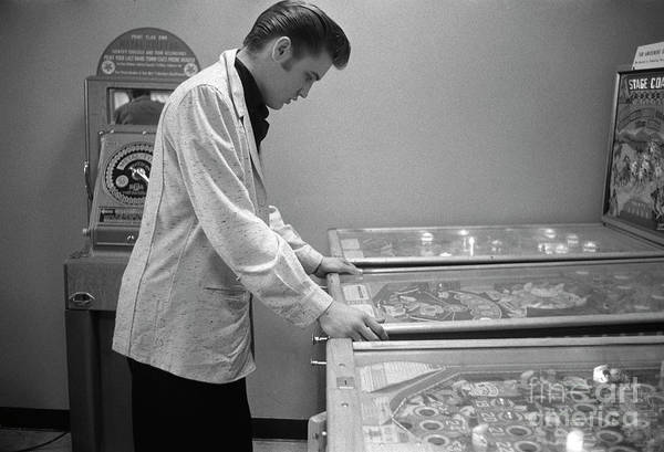 Wall Art - Photograph - Elvis Presley Playing Pinball 1956 by The Harrington Collection