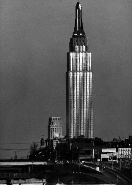 Photograph - Empire State Building Appearing To Stand by Andreas Feininger