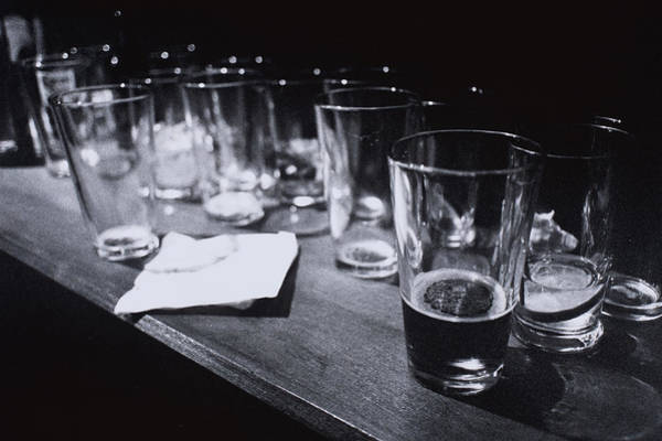 Bar Counter Photograph - Empty Beer Glasses On Table by Henry Horenstein