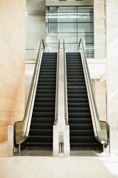 Determination Photograph - Empty Escalators In Lobby by Hybrid Images
