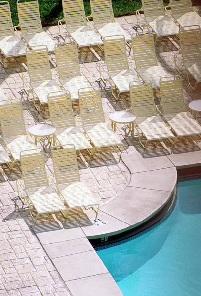 Lounge Chair Photograph - Empty Poolside Chairs At A Holiday by Wesley Hitt