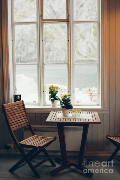Photograph - Empty Table And Antique Wooden Chairs Near A Window by Joaquin Corbalan