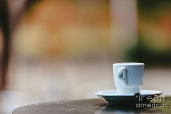 Photograph - Empty White Coffee Cup On The Wooden Table Of An Outdoor Bar, Negative Space For Text. by Joaquin Corbalan