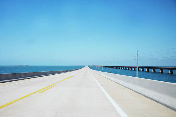 Southern Usa Photograph - Endless Straight Road Over The Ocean by Ideeone