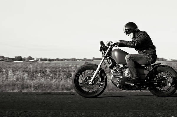 Crash Helmet Photograph - Enjoying A Motorcycle Ride In The Sunset by Vtwinpixel