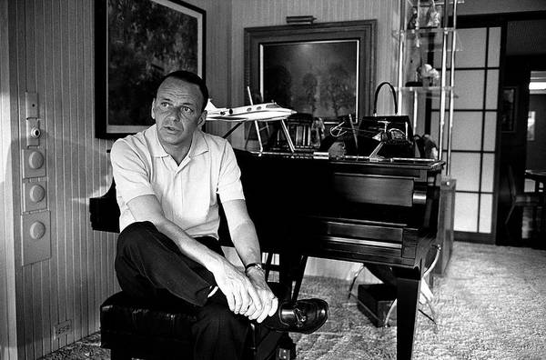 Piano Photograph - Entertainer Frank Sinatra Sitting On by John Dominis