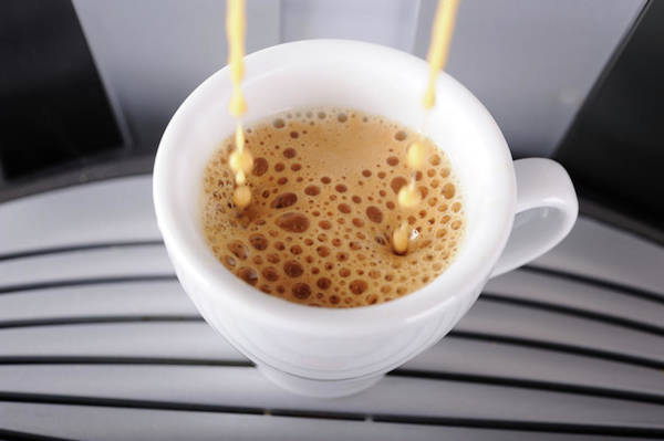Faucet Photograph - Espresso Pouring Into Cup by Gm Stock Films