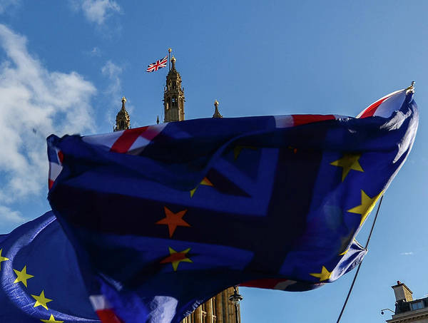 Photograph - Eu Flags And British Flag In Front Of Each Other With Victoria Tower, Westminster, London, Uk In Background - Brexit Theme by Alexandre Rotenberg