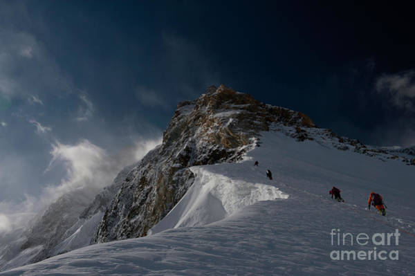 Photograph - Expedition Members Climb A Snow Slope Below Camp II. by Tommy Heinrich