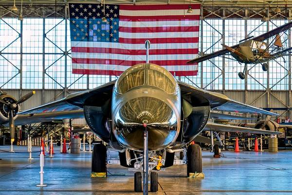 Wall Art - Photograph - F-111 With Flag by Hayman Tam