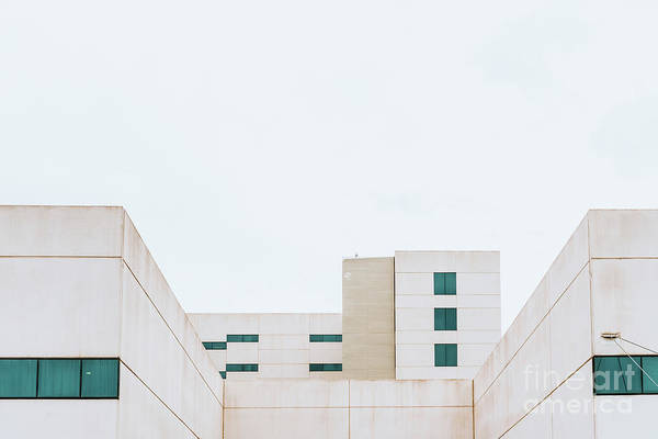 Photograph - Facade Of A White Building With Simple And Minimalist Straight L by Joaquin Corbalan
