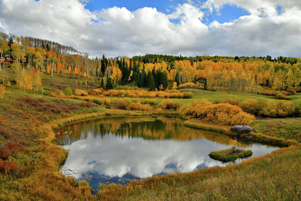 Photograph - Fall Colors And Clouds Reflected In Mountain Village Pond by Ray Mathis