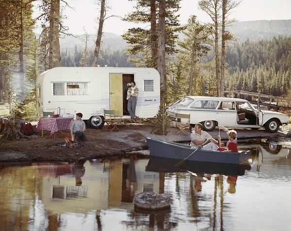 Photograph - Family Enjoying Beside Lake by Tom Kelley Archive