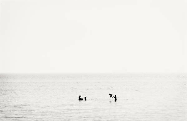 Wall Art - Photograph - Family Having Fun In The Shallow Water by Panoramic Images