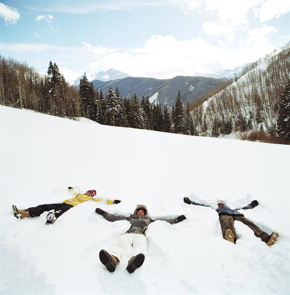 Wall Art - Photograph - Family Making Snow Angels by Brian Bailey