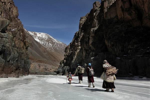 Family Walking Down Frozen River Art Print