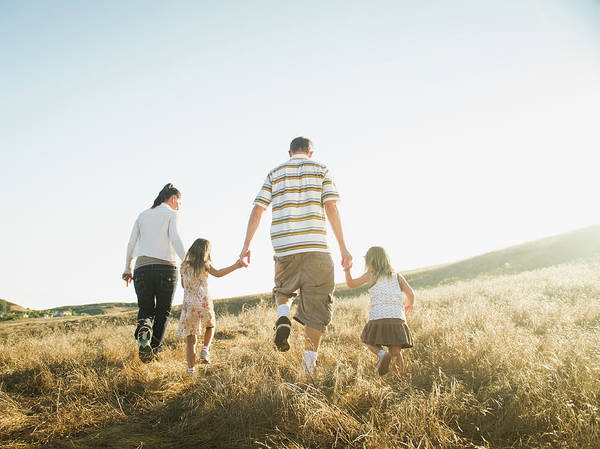 Endurance Race Photograph - Family Walking Together In Rural Field by Erik Isakson