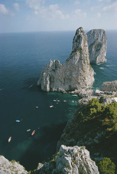 Landscape Photograph - Faraglioni Rocks by Slim Aarons