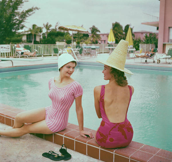 Fashionable Photograph - Fashionable Women Lounging At Poolside by Bettmann