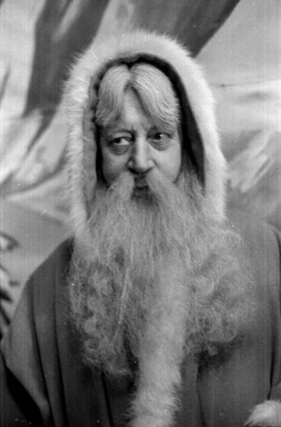 Dressing Up Photograph - Father Christmas by Kurt Hutton