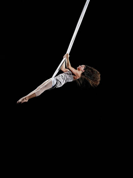 Coordination Wall Art - Photograph - Female Aerialist Swinging On Suspended by Thomas Barwick
