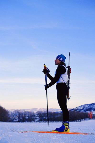 Rifle Photograph - Female Biathlete Holding Ski Poles by Nathan Bilow