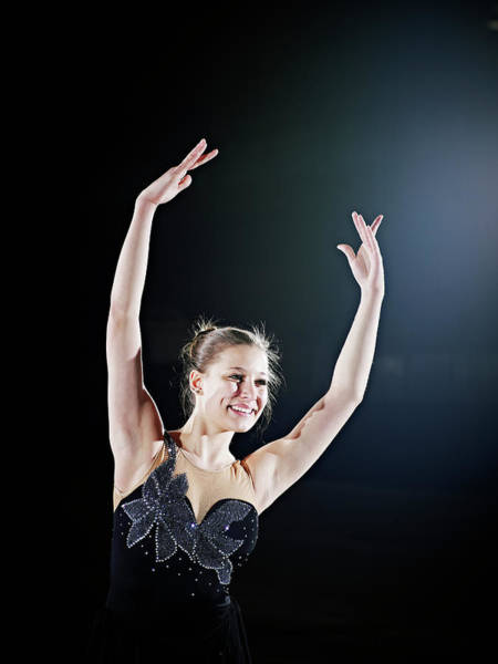 Human Arm Photograph - Female Figure Skater Posing With Arms by Thomas Barwick