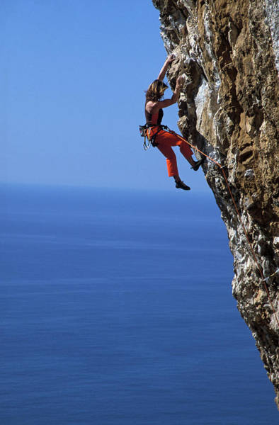 Climbing Photograph - Female Free Climber Scaling Rock Face by Hermann Erber / Look-foto
