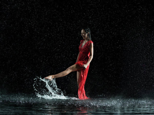 Red Dress Photograph - Female In Red, Foot Splashing In Water by Jonathan Knowles
