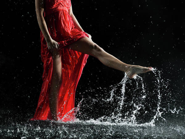 Red Dress Photograph - Female In Red, Legs Splashing In Water by Jonathan Knowles