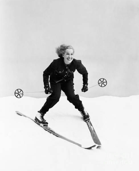 Wall Art - Photograph - Female Skier Skiing Downhill by Everett Collection
