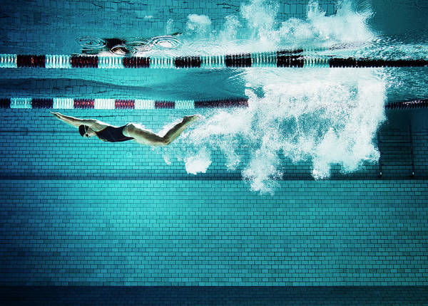 Underwater Photograph - Female Swimmer Underwater In Pool by Henrik Sorensen