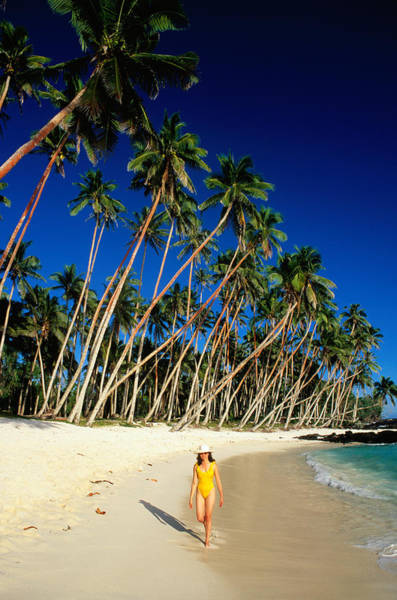 Arrival Photograph - Female Tourist On Return To Paradise by Peter Hendrie