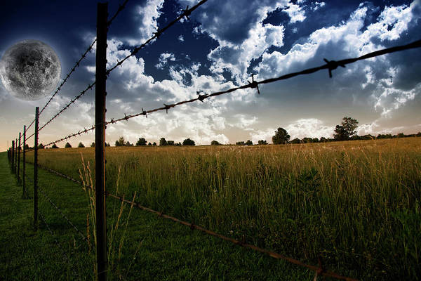 Photograph - Fence On A Farm Field With Giant Full by Bruce Rolff