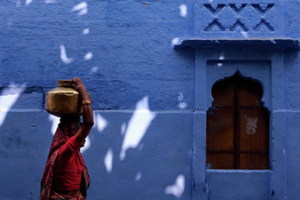 Real People Photograph - Fetching Water by Claude Renault