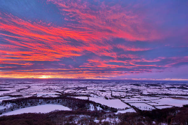 Snowfield Photograph - Fiery Sunset Over A Snow Covered by Lizzie Shepherd / Robertharding