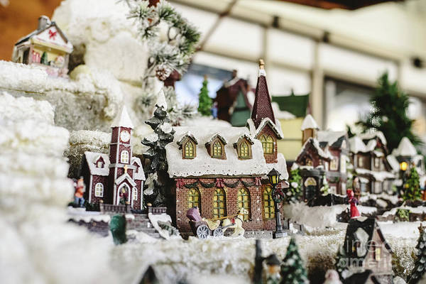 Photograph - Figures And Christmas Decorations In Nordic Style, Miniature Houses With A Snowy Village. by Joaquin Corbalan